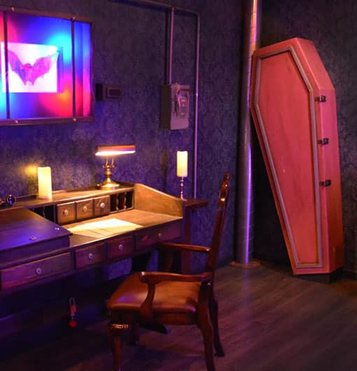 wooden coffin and a cabinet props to solve the puzzle